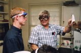 Alan Fossett helps a student in a lab.
