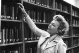 Dorothy L. Argow browsing in the library